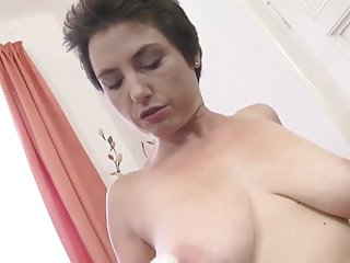 Fine-looking experienced woman is fingering her twat