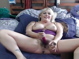 Chubby but sexy blonde Joclyn Stone with a full hairy pussy