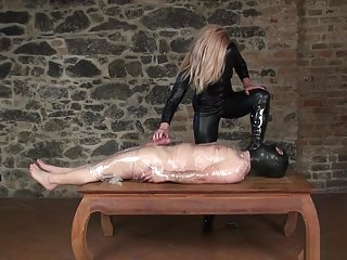 milf mistress in high boots and catsuit uses cllingfilmed slave
